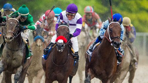 BALTIMORE, MD - MAY 21: Nyquist #3, ridden by Mario Gutierrez, (C) leads the field out of the fourth turn as Exaggerator #5, ridden by Kent J. Desormeaux, (L) overtakes in the 141st running of the Preakness Stakes at Pimlico Race Course on May 21, 2016 in Baltimore, Maryland. (Photo by Douglas DeFelice/Eclipse Sportswire/Getty Images)
